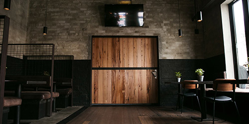 roamn-images-timber-revival-fitout-shopfitter-interior-recycled-timber-door-hospitality-cafe-bar-melbourne-tables-benchseats-northcote-social-club-breathe-architecture