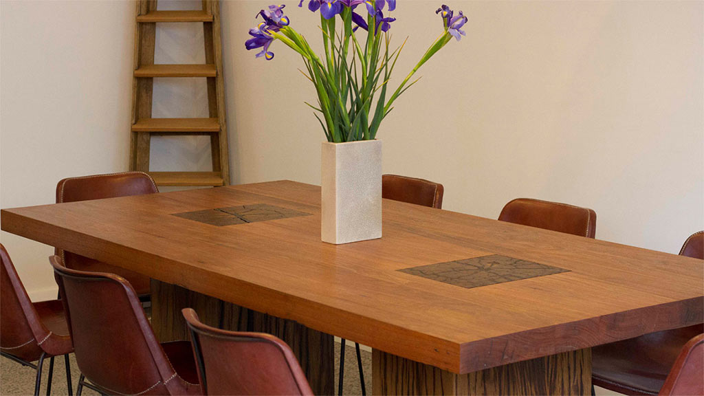 Recycled timber dining table with Ironbark post table legs