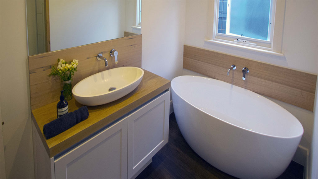 Light tones of our Messmate blend used for vanity top and bath splash back