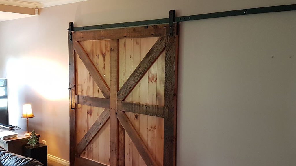 Recycled timber used to create internal sliding barn door