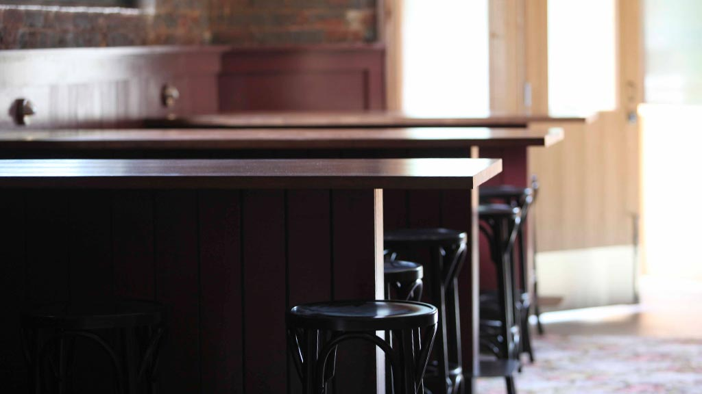 Recycled timber standing tables at Victoria Hotel Footscray