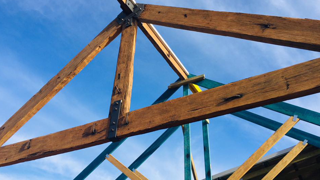 Recycled wharf timbers repurposed as trusses